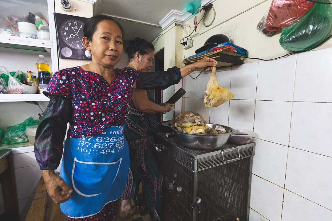 A woman holds a chicken inside Pho Lam Nam Ngu restaurant in Hanoi