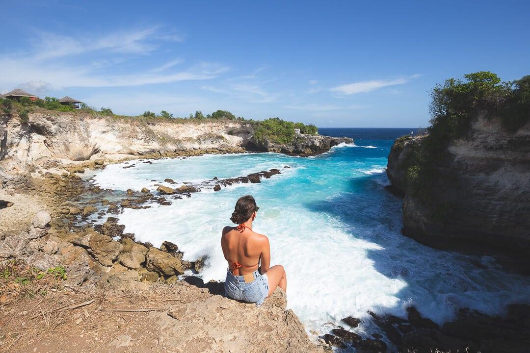 Sindhya of Why We Seek sits on the edge of the Blue Lagoon on Nusa Ceningan Island Bali