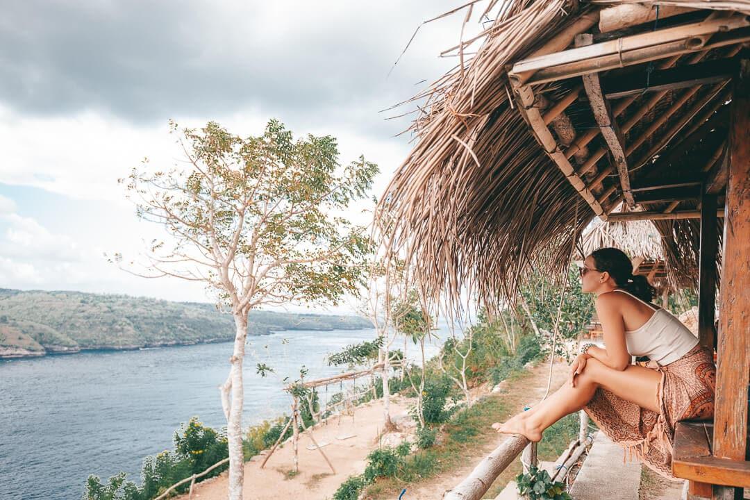 Sindhya sits at the Ceningan cliffs restaurant on Nusa Ceningan Island Bali