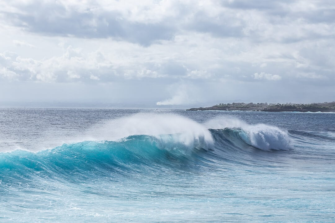 Waves crash near Mahana Point on Nusa Ceningan Bali
