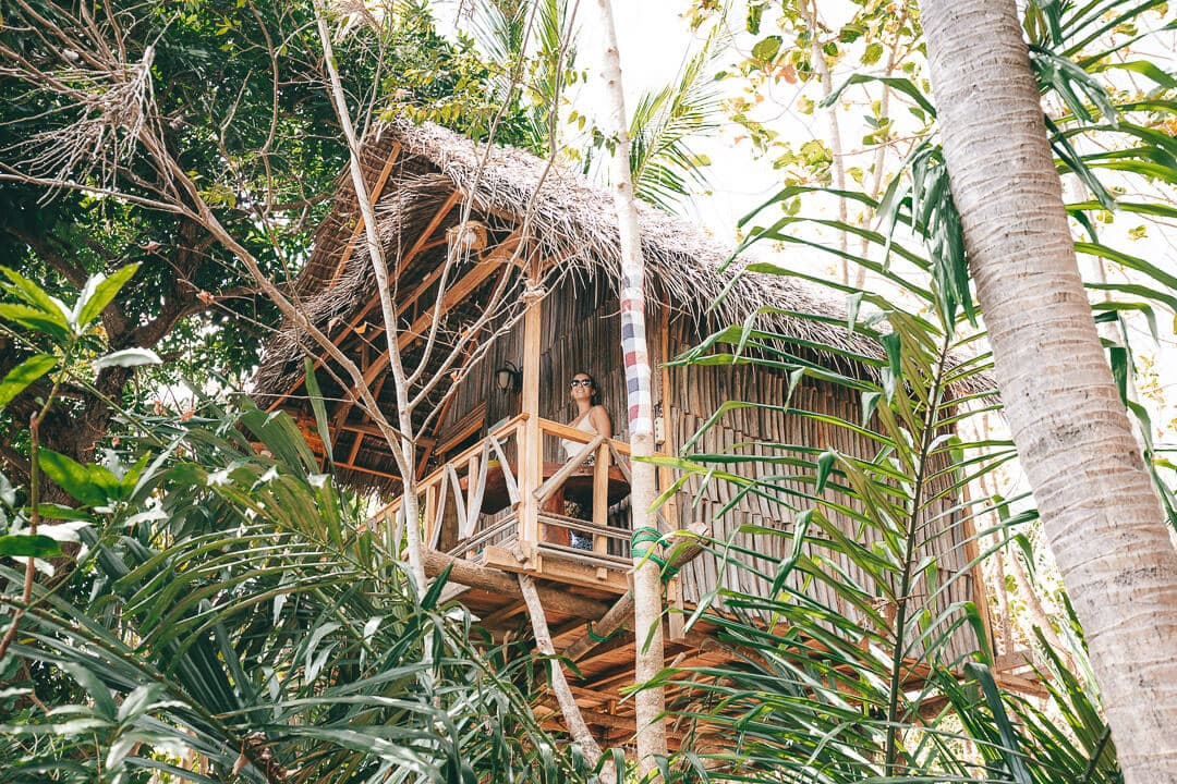Sindhya sits on the porch of our tree house at Nyuh Bengkok on Nusa Penida