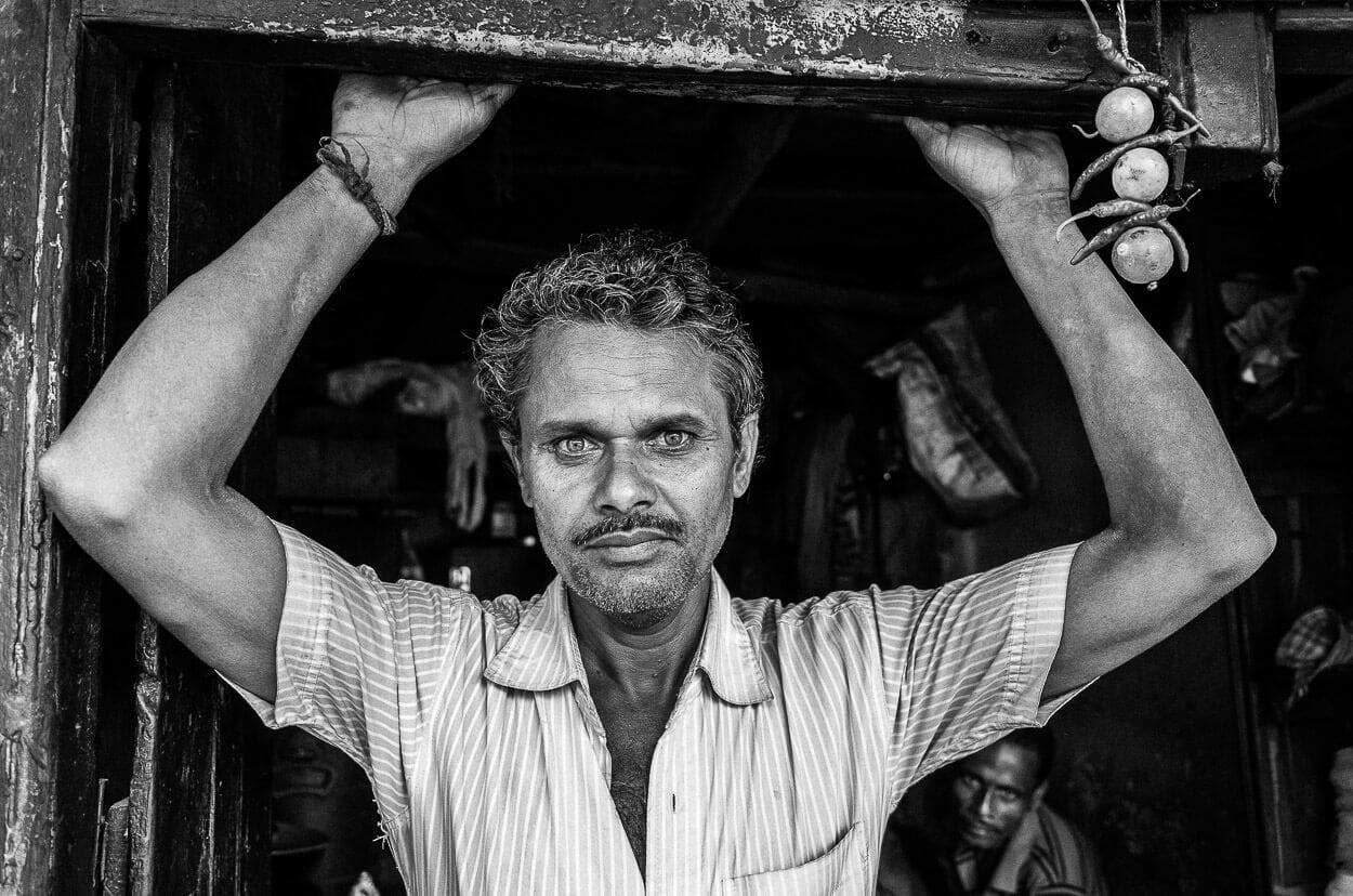 Black and white portrait of a friendly chaiwala in Calcutta