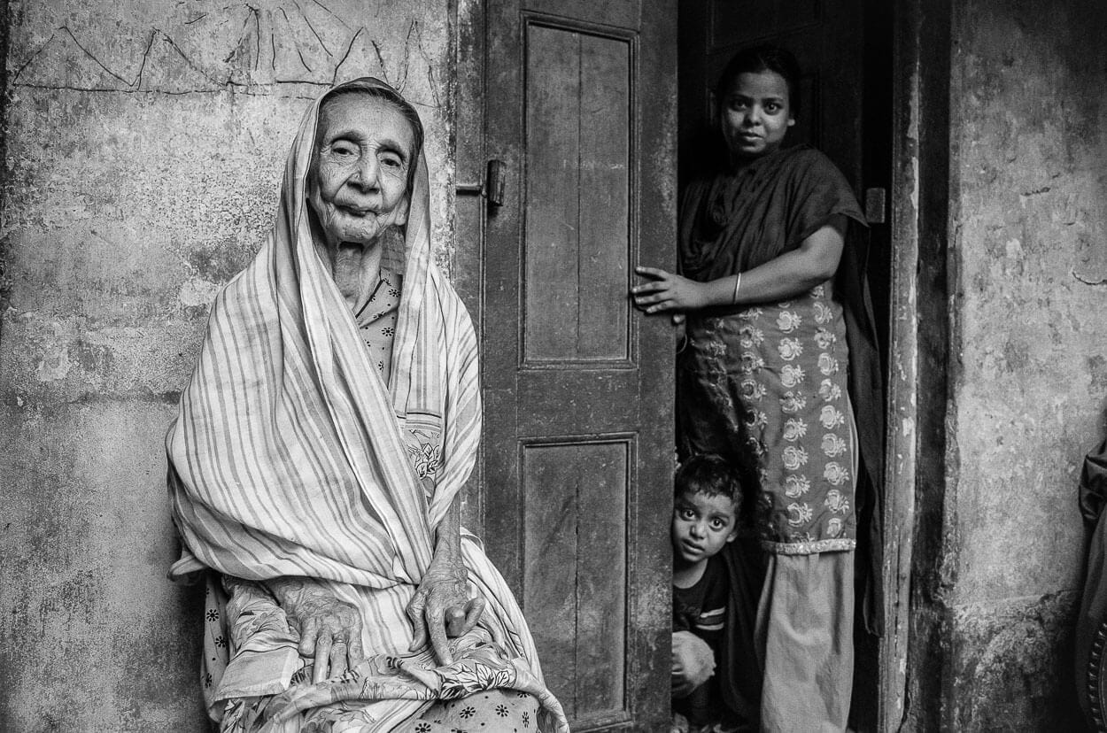 Portrait of an old woman and her family in Kolkata.