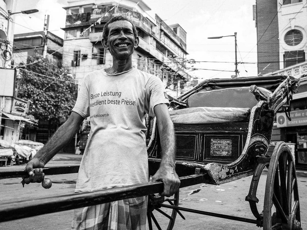 Black and white portrait of a rickshawala in Kolkata, India