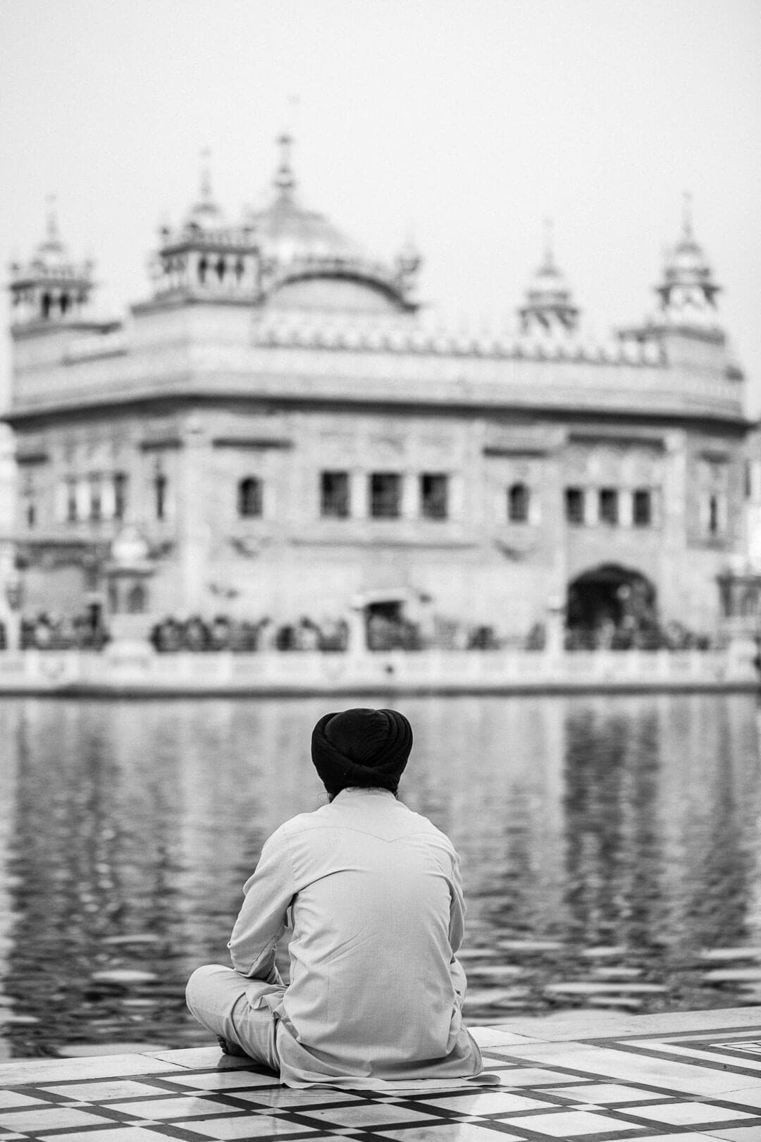 A Sikh man sits quietly at the Golden Temple in Amritsar, India