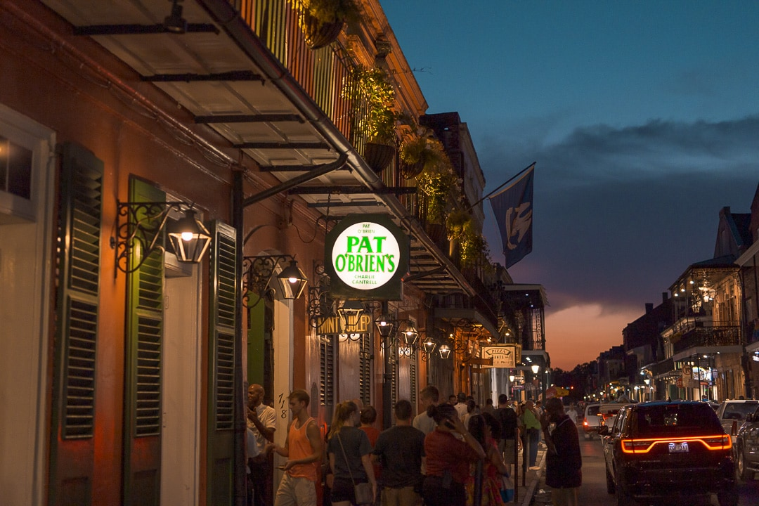 Pat O'brien's in the French Quarter lit up at night in New Orleans
