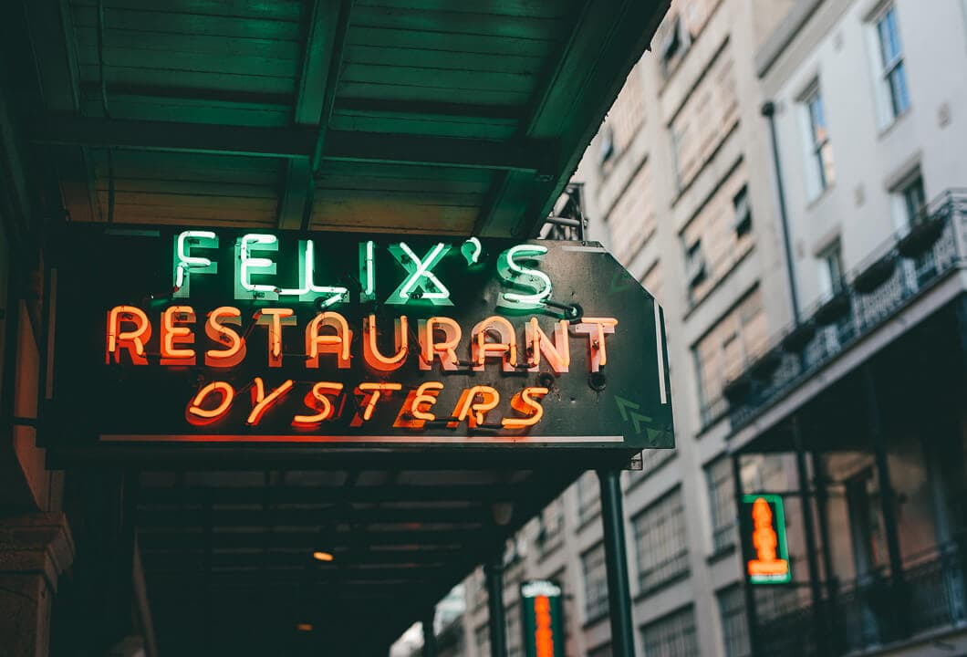 Neon sign in front of Felix's restaurant Where to Eat in New Orleans