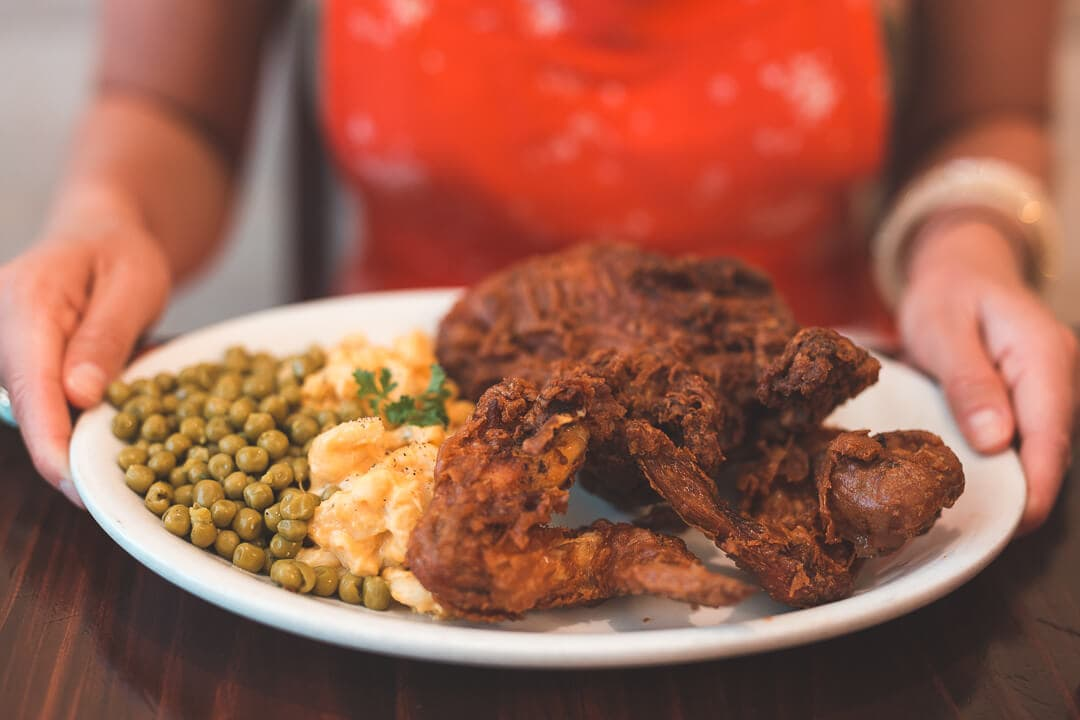 A plate of fried chicken and peas at Willie Mae's Scotch House