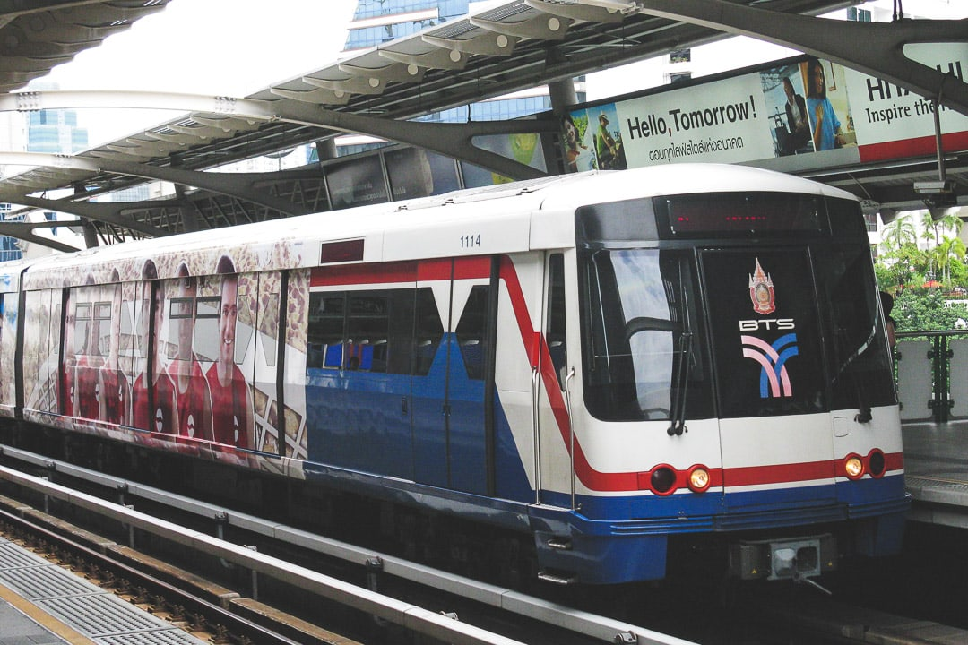 BTS Skytrain pulls into a station in Bangkok, Thailand