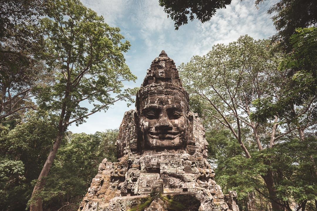 The smiling Buddha head on top of Angkor Thom's north gate