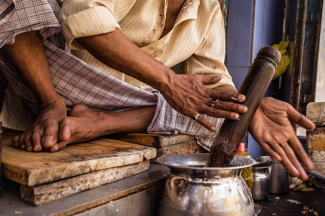 A man mixes a lassi at the Blue Lassi Shop in Banares