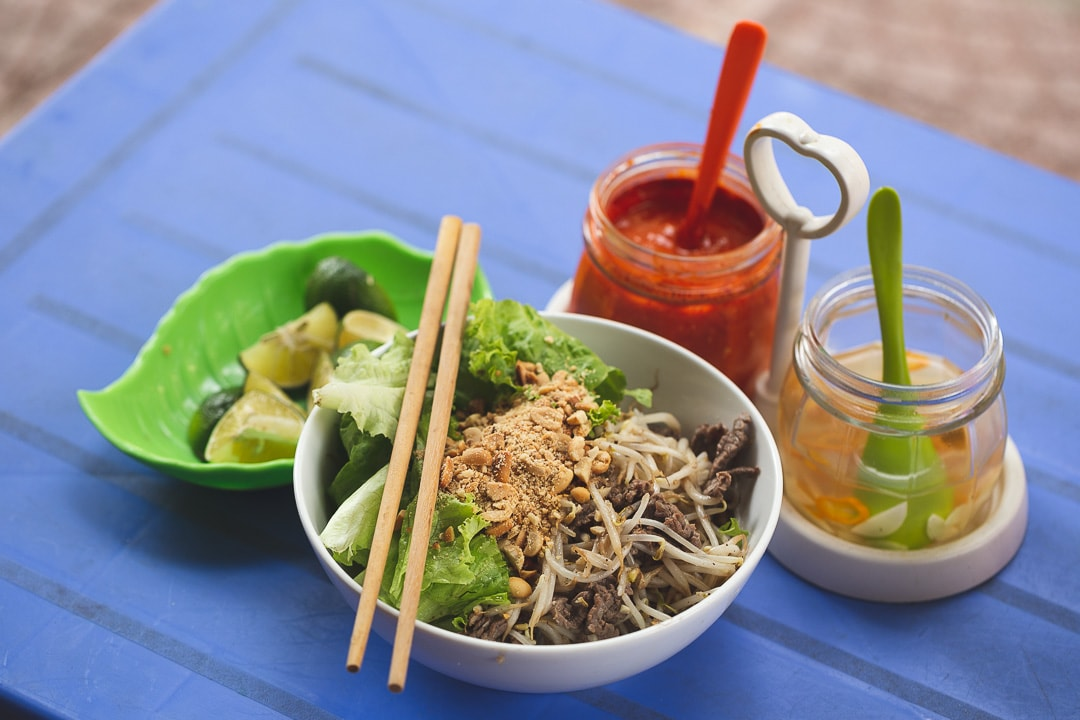 Bun bo nam bo with chili sauce and garlic vinegar. Vietnamese foods you must try in Hanoi.