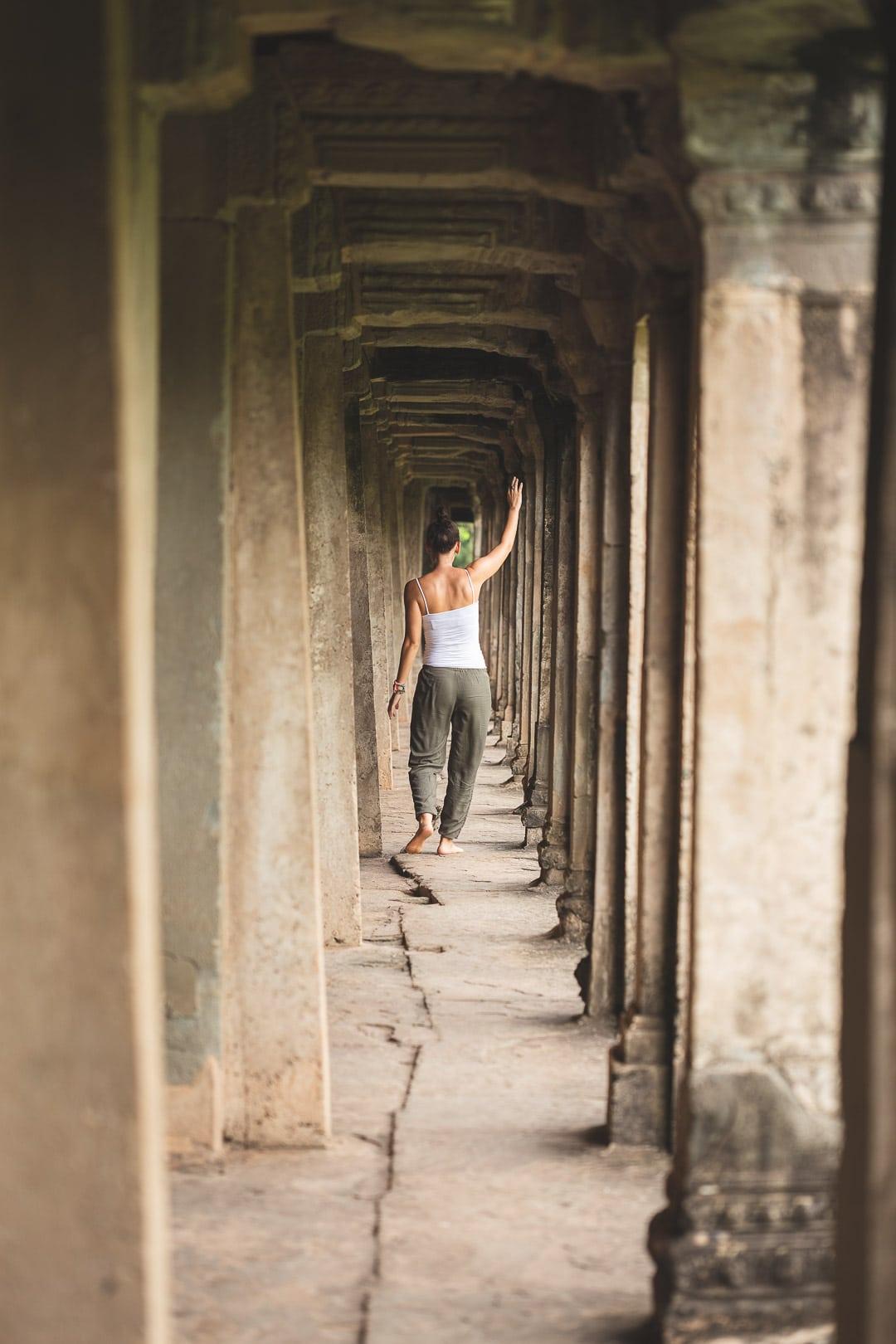 Sindhya skips through the hallways of Angkor Wat