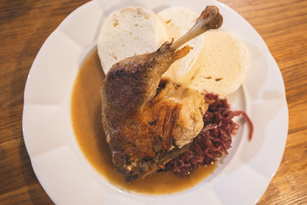 A olate of duck confit with cabbage and bread dumplings in Prague