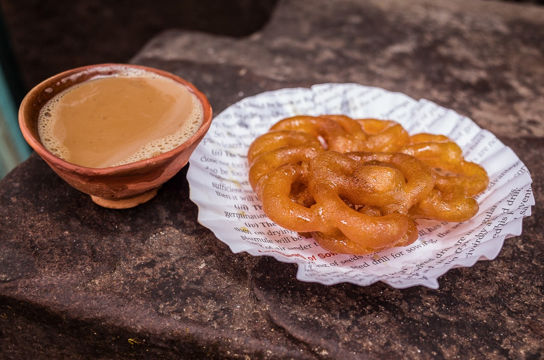 A hot cup of chai and a jalebi for breakfast in India