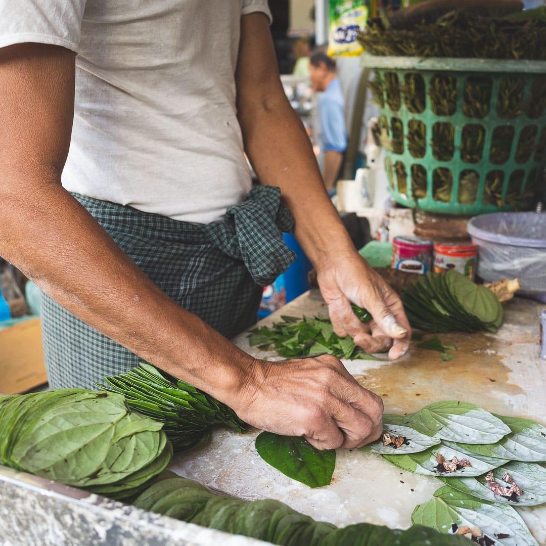 A man makes konya or betel nut chew in Yangon, Myanmar