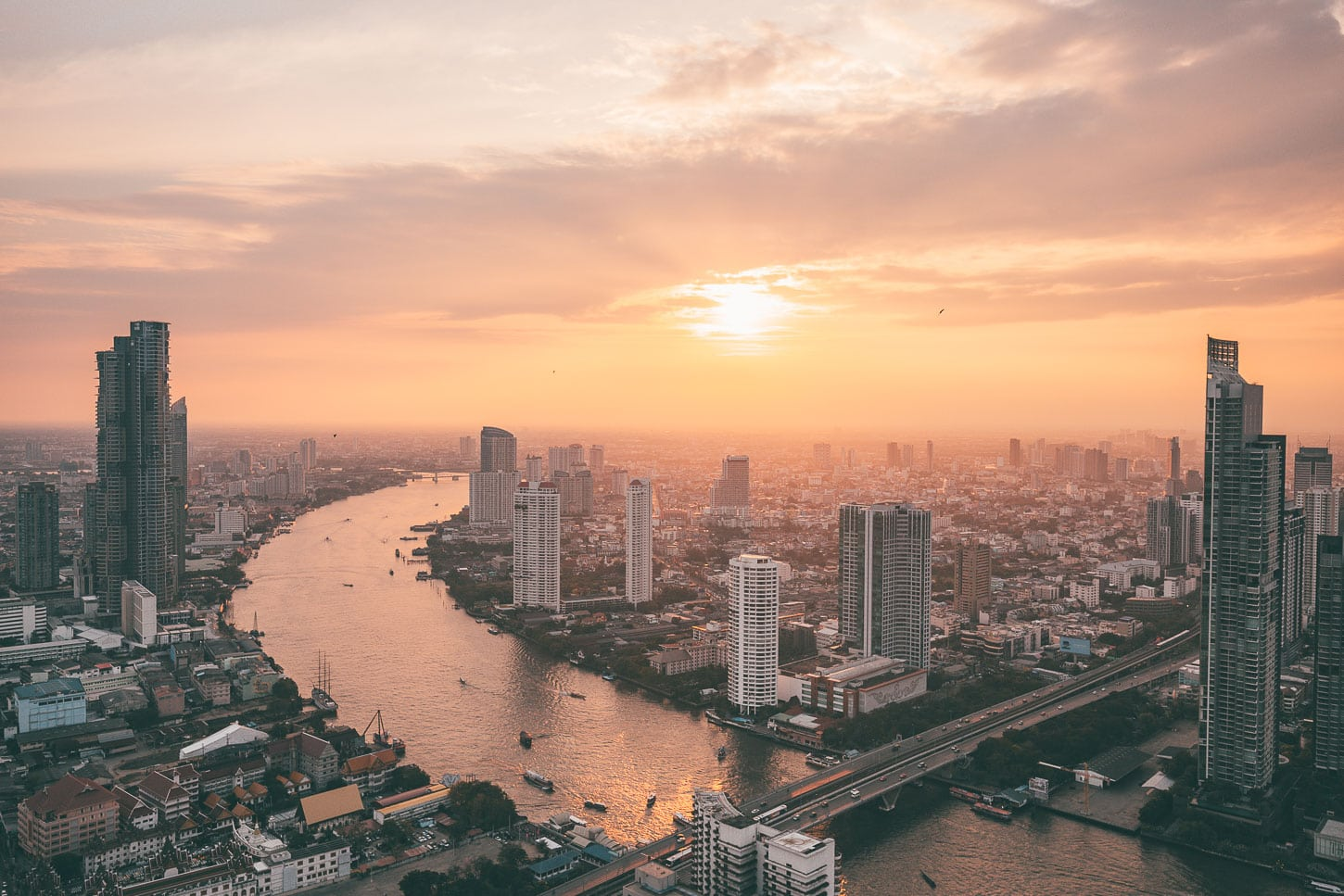 View from Lebua State Tower over the Chao Phraya river in Bangkok at sunset