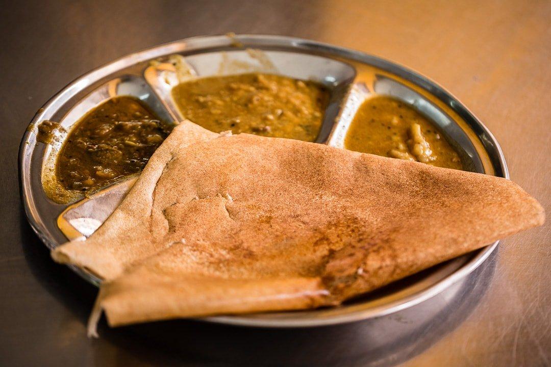Indian food masala dosa plate on 32nd street in Yangon, Myanmar