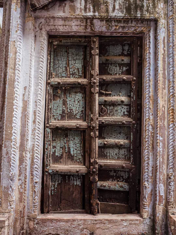 An old cracking and crumbling door in Varanasi, India Uttar Pradesh