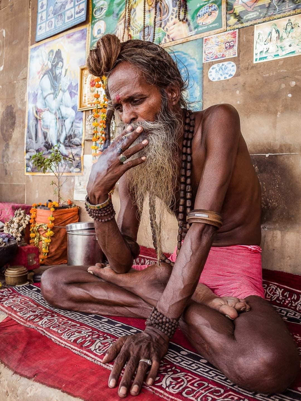 A Sadhu along the ghats of Varanasi smoking marijuana