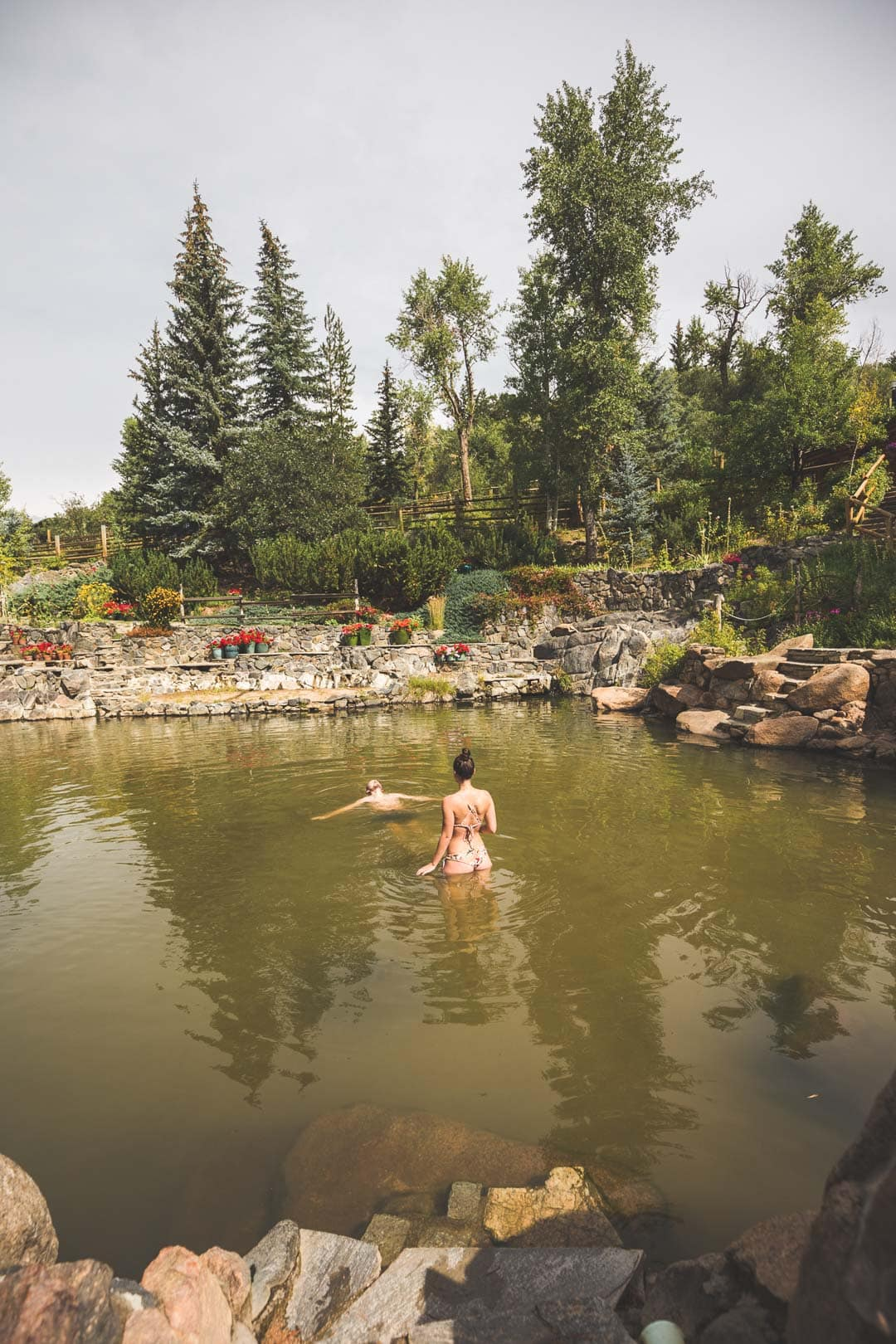 A couple enjoying hot springs together in Steamboat Springs, Colorado