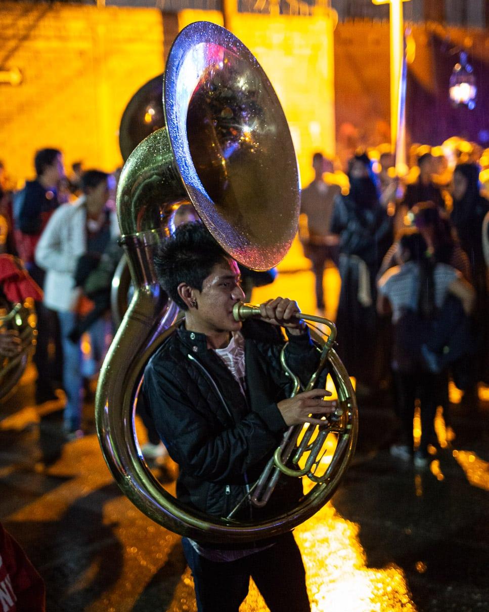 Tuba player in a comparsa for Dia de Muertos in Oaxaca