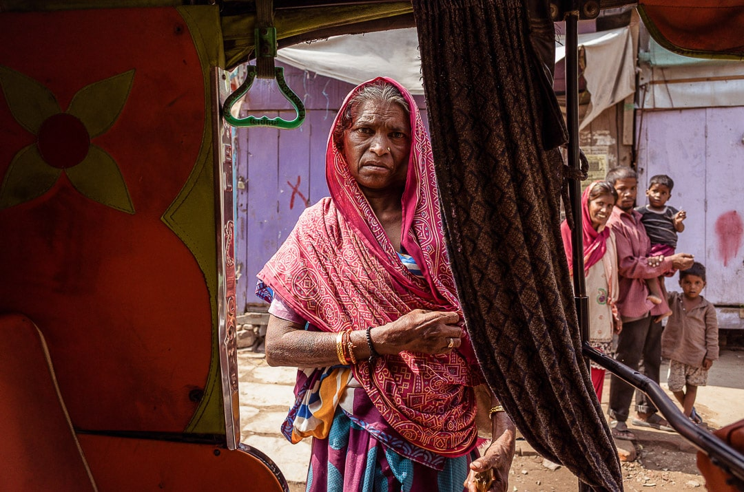 A woman looks into our rickshaw in Varanasi, India