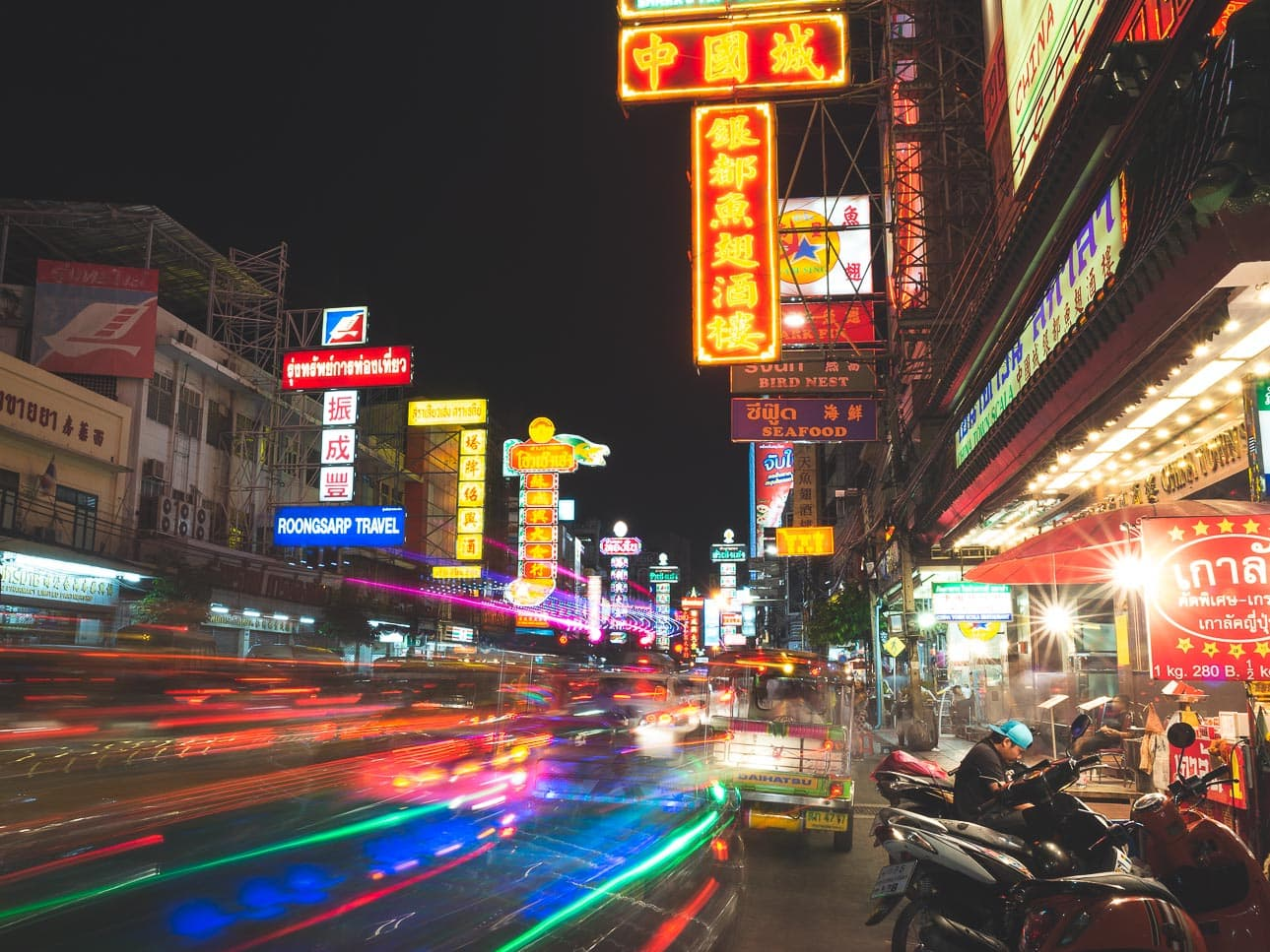 Long exposure shot at night along Yaowarat road in Bangkok, Thailand