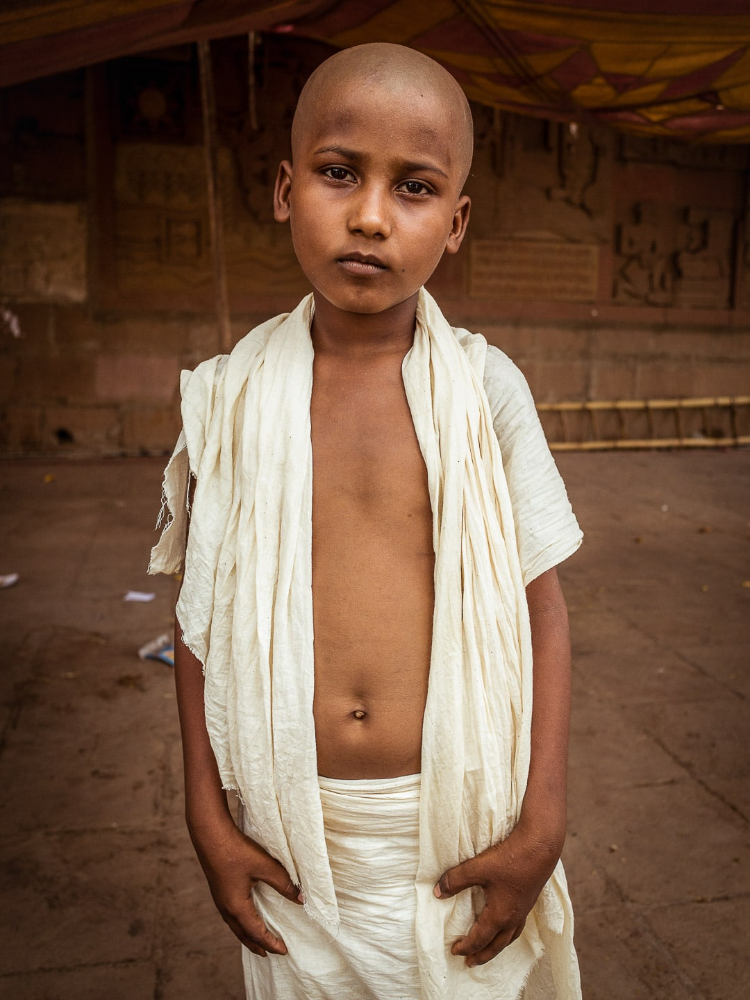 A young mourner in white clothing near the Varanasi ghats