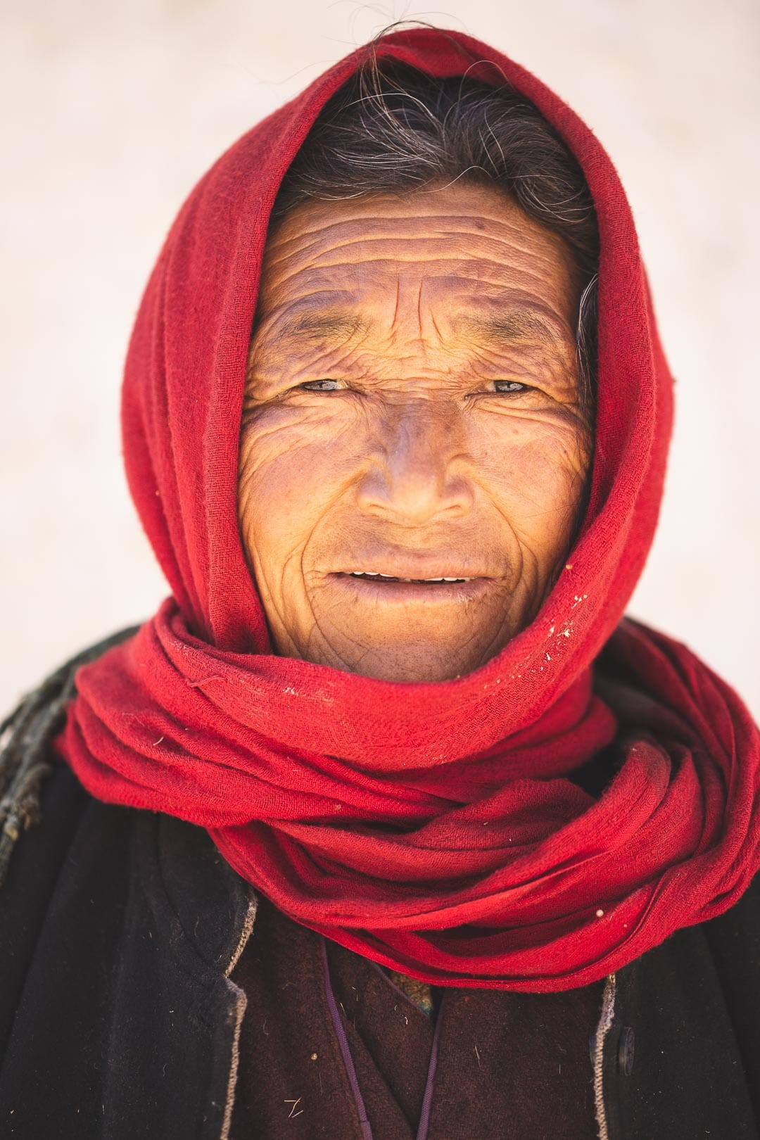 Portrait of a Ladakhi woman near her home in Sara Village