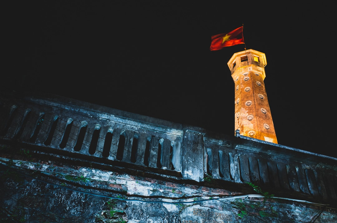 The Flag Tower of Hanoi lit up at night on Dien Bien Phu Street