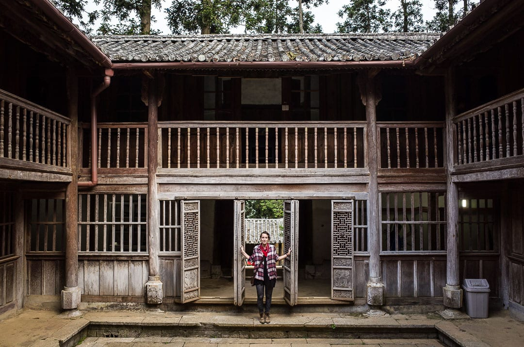 Sindhya stands in the doorway at the Hmong King Palace in Ha Giang, Vietnam