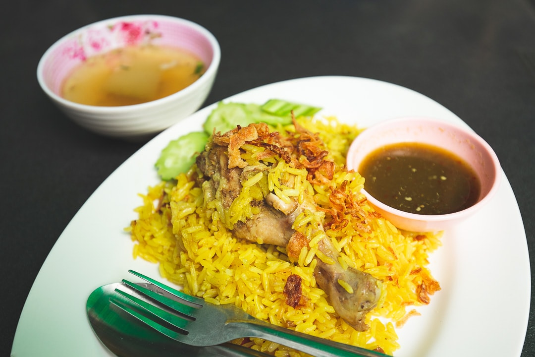 A plate of Khao Mok Gai - Thai chicken biryani in Bangkok, Thailand