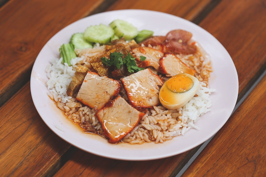 A plate of Khao Moo Daeng Moo Krob - Red BBQ Pork in Bangkok, Thailand