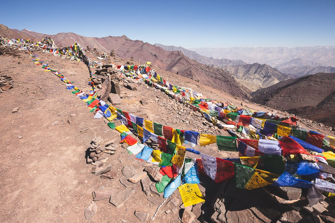 Prayer flags cover the summit of Kongmaru La in Ladakh, India Kashmir