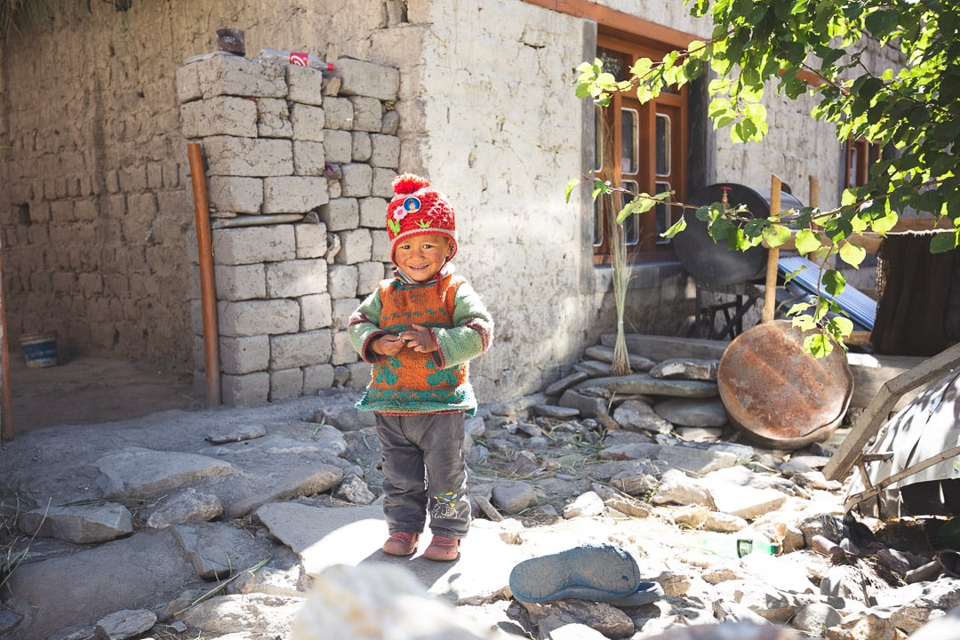 A young boy from Kaya Village in front of his home in Markha Valley