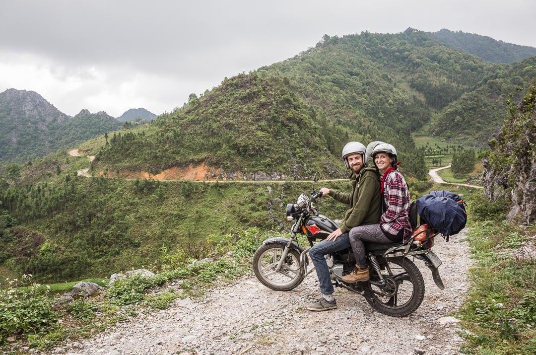 Sindhya and Matt of Why We Seek on a motorcycle in Ha Giang, Vietnam