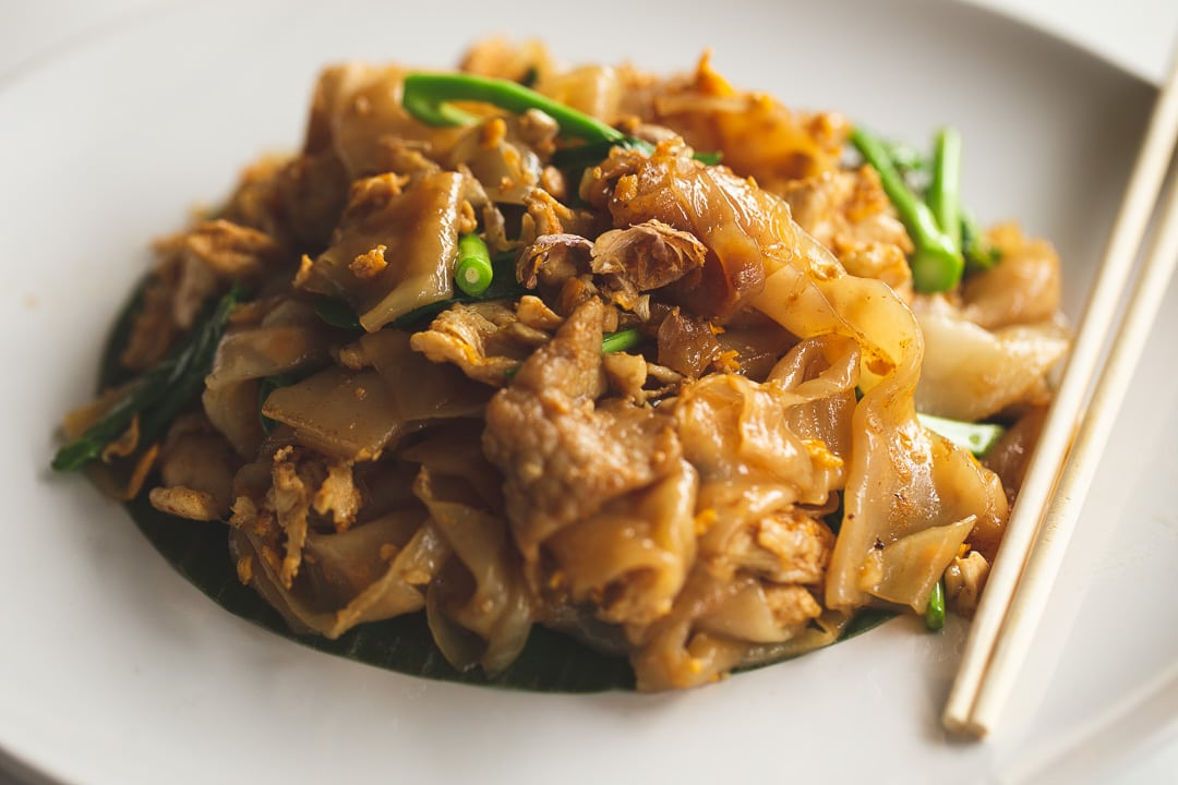 A plate of Pad See Ew a stir fried wide noodle dish in Bangkok, Thailand