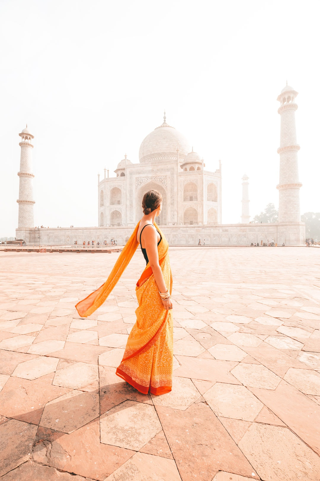 Sindhya of travel blog Why We Seek in front of the Taj Mahal in Agra, India.