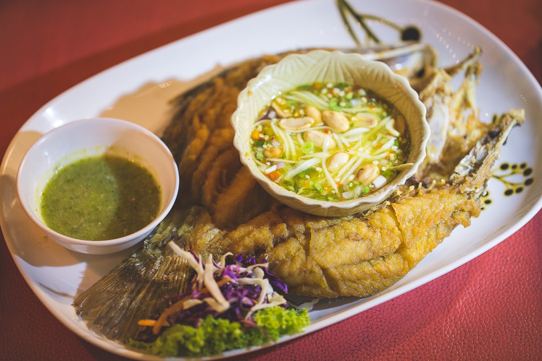 Deep fried seabass with green mango salad in Bangkok, Thailand
