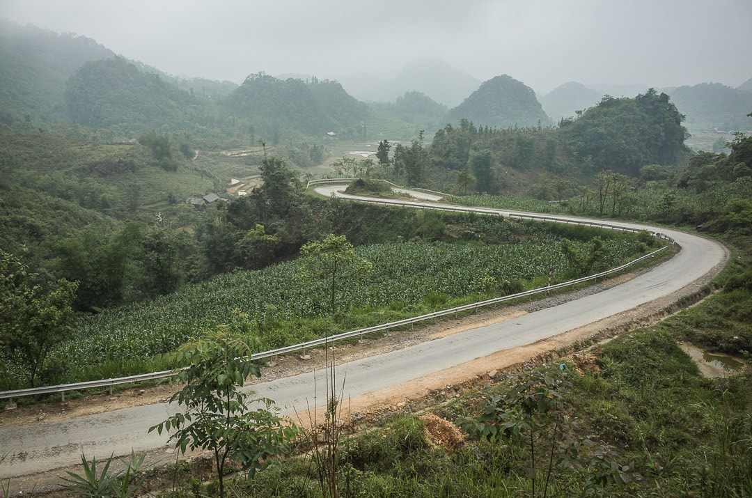 A winding road through the Dong Van Karst Plateau Geopark in Ha Giang Vietnam