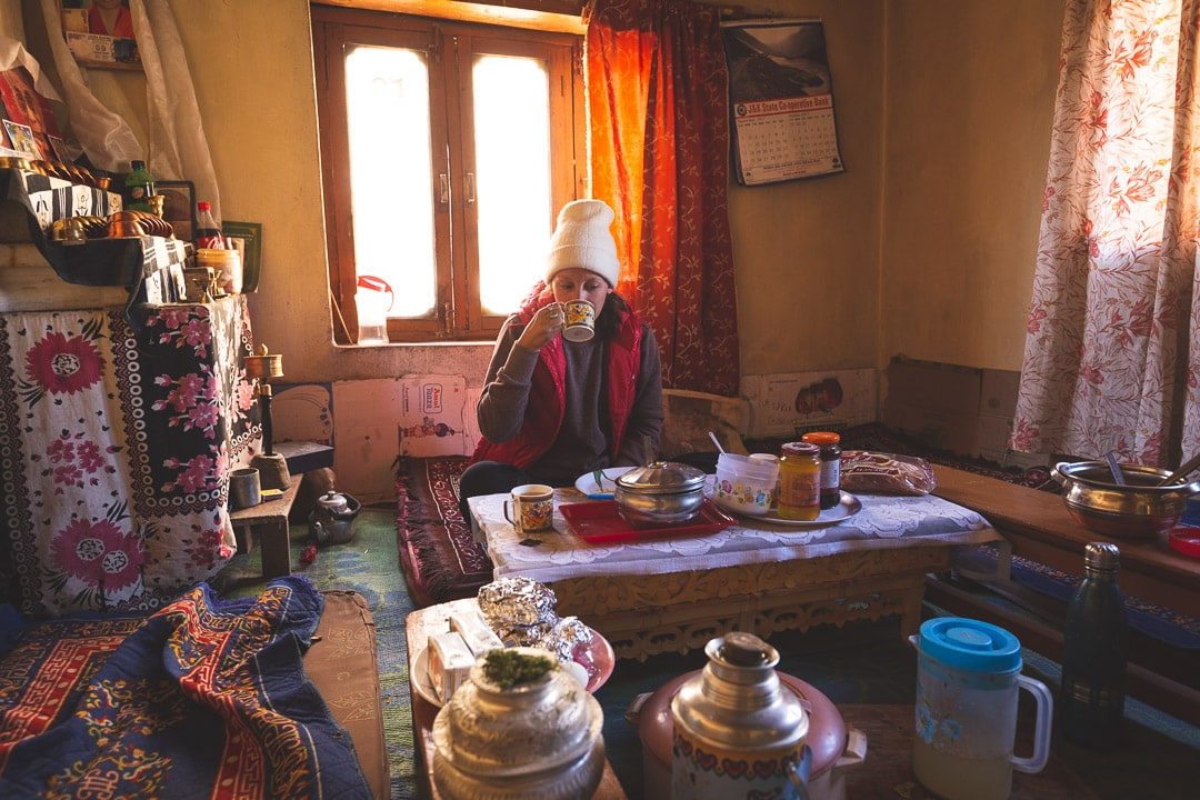 Sindhya of Why We Seek drinks tea in a homestay in Ladakh, India