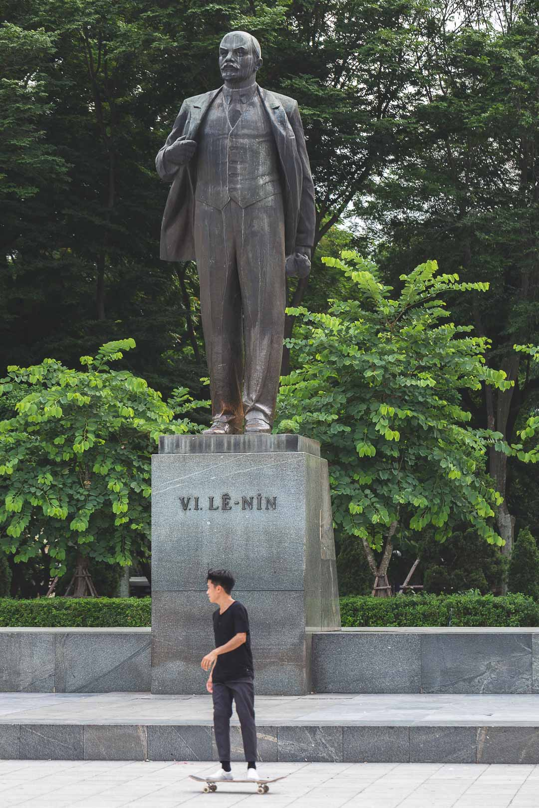 A skateboarder rides past the Lenin statue in Hanoi, Vietnam