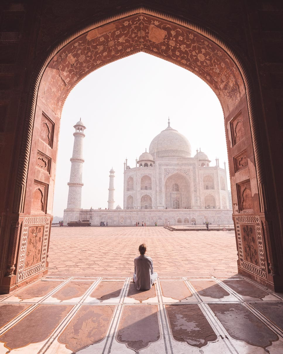 Matt sitting in the archway of the mosque across from the Taj Mahal admiring it all.