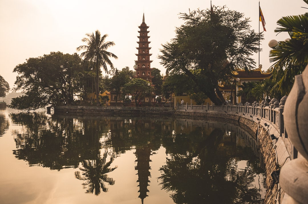 Tran Quoc Pagoda on West Lake in Hanoi at sunset