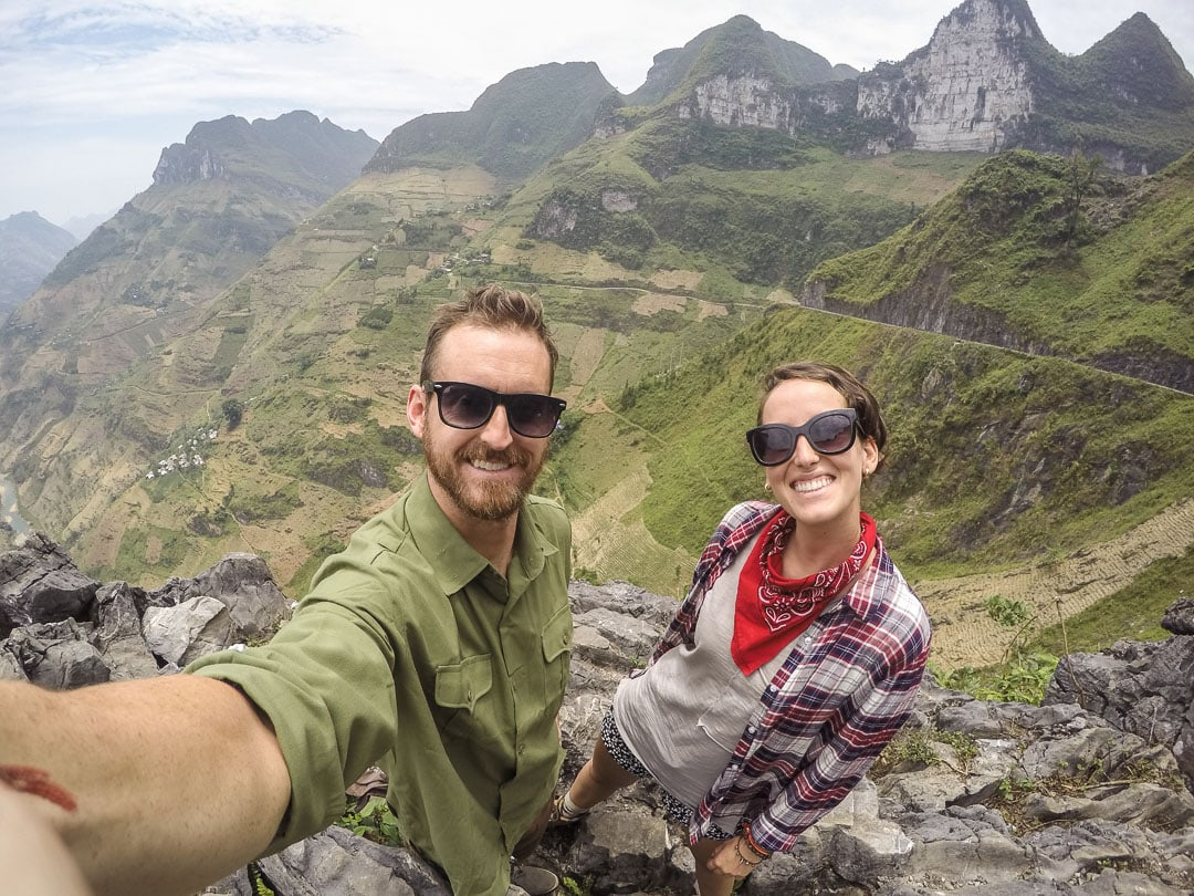 Travel bloggers Why We Seek on Ma Pi Leng Pass in Ha Giang, Vietnam
