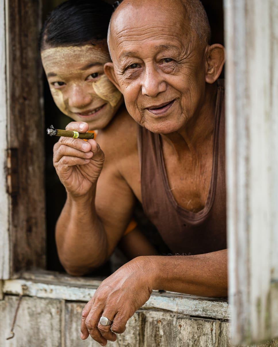 Grandpa and granddaughter portrait in Dala Township Myanmar