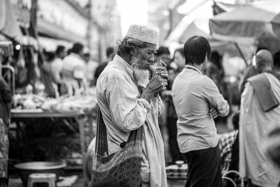 A Muslim man lights a cigar in Yangon
