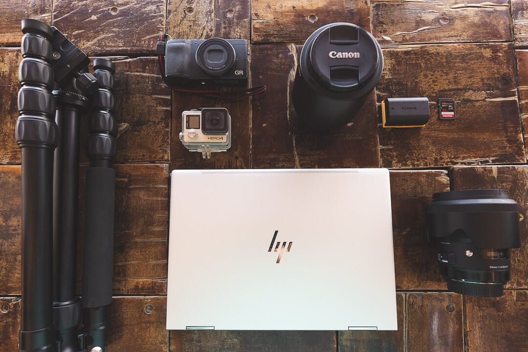 Photography and travel blog equipment spread out on a table