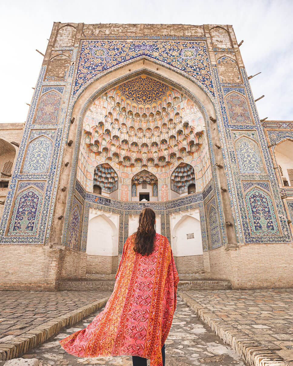 Sindhya stands in front of Abdulaziz-Khan Madrassa in Bukhara